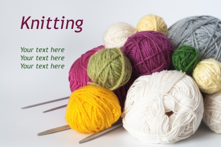 A lot of bright balls of yarn and knitting needle photo