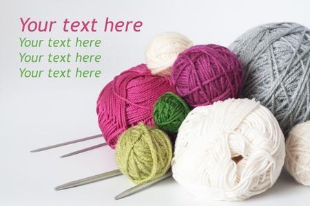 A lot of bright balls of yarn and knitting needle Stock Photo
