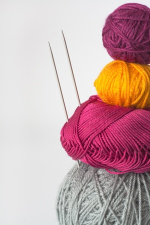 Bright tangle of thread and knitting needle