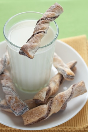 A glass of milk and tasty cookies photo