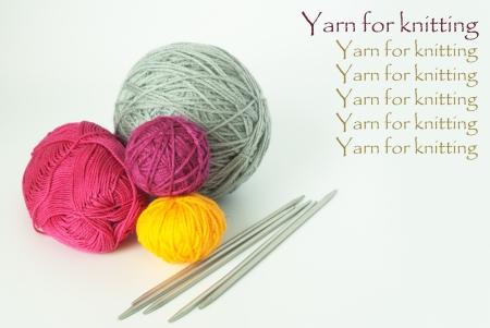 Bright balls of yarn for knitting and knitting needle photo