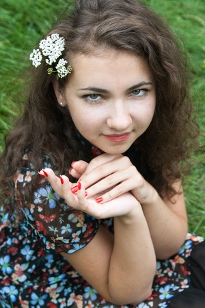 french manicure sexy woman: Portrait of a beautiful young brunette with flowering branches