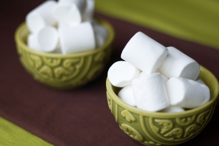 Two national oriental bowls with white marshmallows photo