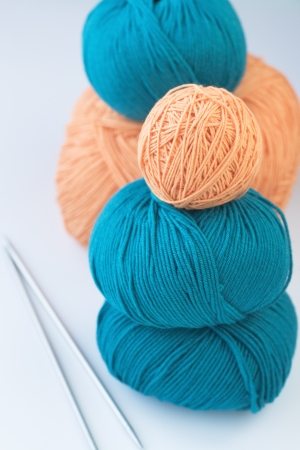 hobie: Five bright balls of yarn and two knitting needles