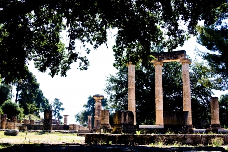 The ancient ruins of the sunny day at Olympia, Greece photo
