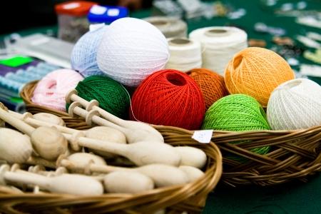 Multi-colored bright skeins of thread and bobbin photo