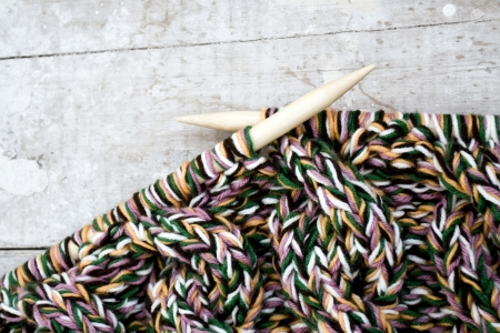 Knitting needles and yarn on wooden  photo