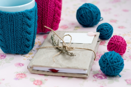 Two blue cups in blue and pink sweater with ball of yarn for knitting Stok Fotoğraf