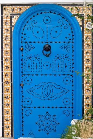 sidi bou said: Blue doors and white wall of building in Sidi Bou Said, Tunisia