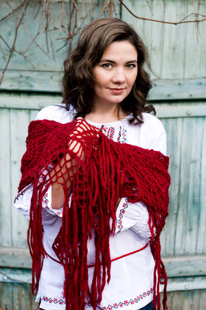 traditional plants: Portrait of a beautiful young Ukrainian embroidered shirt and knitted red kerchief