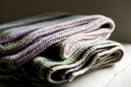pink stripes: Knitting striped rug with white, purple, green and pink stripes Stock Photo