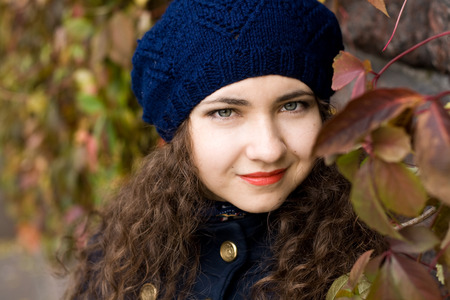 Portrait of young beautiful brunette in blue beret Stock Photo