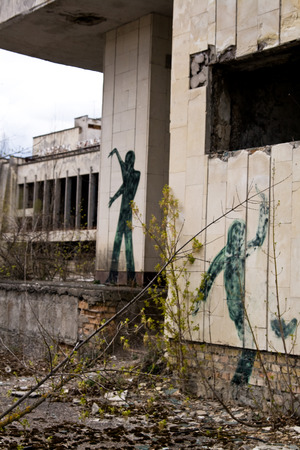 Graffiti on abandoned central square in Pripyat ghost town, Chernobyl Nuclear Power Plant Zone of Alienation, Ukraine photo