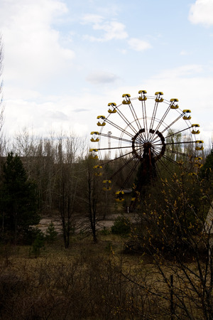 alienation: Ferris wheel in Pripyat ghost town, Chernobyl Nuclear Power Plant Zone of Alienation, Ukraine Stock Photo
