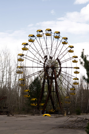 pripyat: Ferris wheel in Pripyat ghost town, Chernobyl Nuclear Power Plant Zone of Alienation, Ukraine Stock Photo