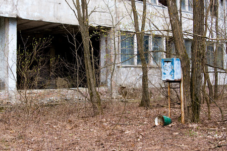 alienation: Mailbox in one of the abandoned streets in Pripyat ghost town, Chernobyl Nuclear Power Plant Zone of Alienation, Ukraine