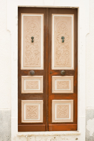 front house: Locked Wooden Front Door of the Old House in Mahdia, Tunisia Stock Photo