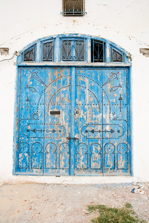 front house: Locked Wooden Front Door of the Old House with Big Lock in Mahdia, Tunisia