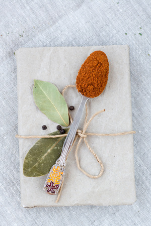 bay leaf: Hot pepper on the spoon, bay leaf and a notebook for recipes