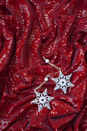 Red festive background with sparkles and two white decorations for Christmas tree for lettering and greeting card