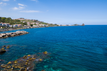 Aci Castello is a municipality in the Province of Catania in Sicily, Italy. The city is located 9 kilometers (6 mi) north of Catania on the Mediterranean coast. The primary economic sectors are agriculture and industry (in Catania). The city is neighbored Stock Photo