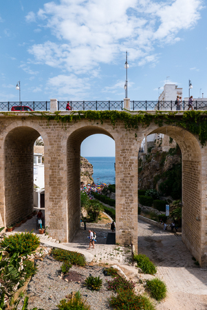 Polignano a Mare, Italy - The famous sea town in the province of Bari, southern Italy. The village rises on the rocky spur over the Adriatic Sea, and is known tourist attraction.