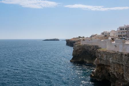 Polignano a Mare: Breathtaking sight, Apulia, Italy. Italian panorama. Cliffs on the Adriatic sea and boat. Editorial