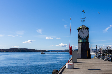 Clock located at the Aker Brygge pier on a beautiful, sunny spring day,Oslo, Norway