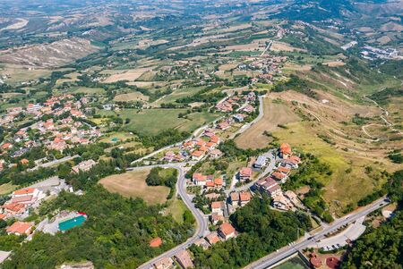 Panoramic view of the  valleys surrounding San Marino, a small independent country surrounded by Italian territory  in a summer day.