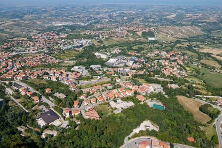 Panoramic view of the  valleys surrounding San Marino, a small independent country surrounded by Italian territory  seen from Guaita in a summer day.