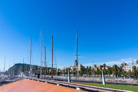 Masts of sailboats in the harbour of Barcelona. Spain.
