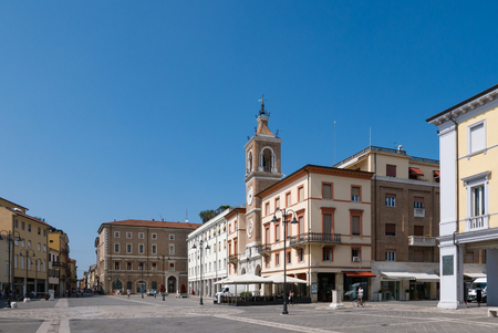 RIMINI - 7 AUGUST 2018:  Square of the Three Martyrs in Rimini with the ancient clock tower, Italy