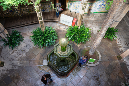 Barcelona, Spain - November 02, 2018: Casa de lArdiaca, courtyard shaded by trees and cooled by fountains. Barri Gotic, Barcelona. Spain.