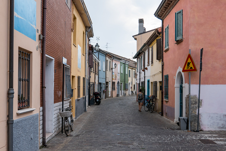 RIMINI, EMILIA ROMAGNA, ITALY -  7 AUGUST 2018: A picturesque narrow street in the ancient district of San Giuliano
