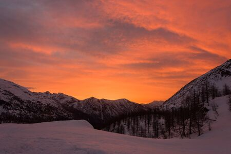 Snowy panorama of the Val Bognanco that opens behind Domodossola at the dawn, Piedmont, Italy