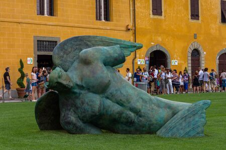 Pisa, Italy - August 19, 2016: the statue of the fallen angel by sculptor Igor Mitoraj