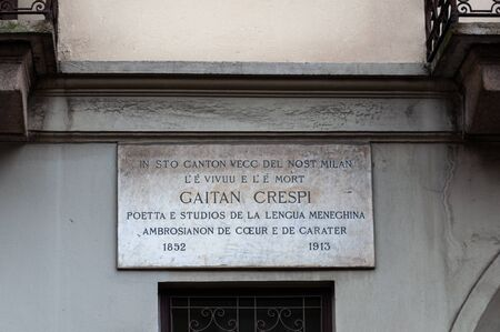 Milan, Italy - April 25 2013: The only commemorative plaque in the Milanese dialect dedicated to the poet Gaetano Crespi located in Via Santa maria Podone 3 in Milan