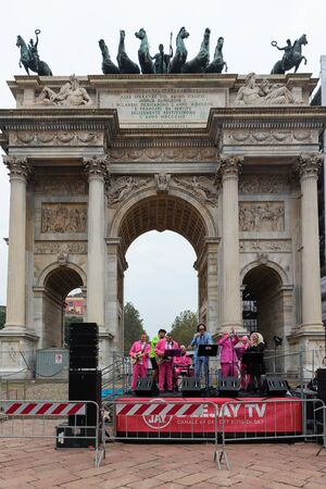 """MILAN, ITALY - OCTOBER 13 2019: The """"I Cormorani"""" musical group welcomes the riders on arrival to celebrate the Deejay Ten, a running event organized by Radio Deejay for the city of Milan."""