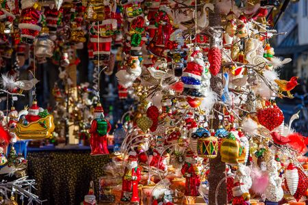 Colored decorations in a stall of the Christmas market in Merano. Trentino Alto Adige, Italy.