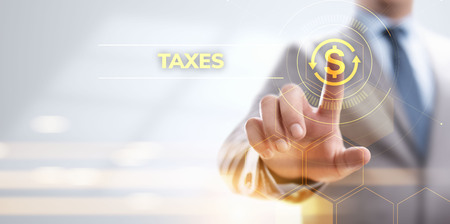 Tax report taxes payment business finance concept. Businessman pointing on virtual screen.
