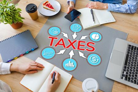Taxes diagram regular government payment VAT business concept on office desktop. Stock Photo