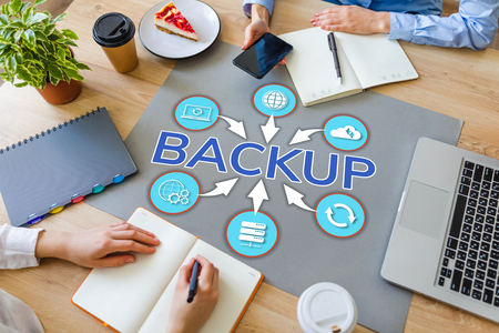 Backup user data security recovery internet technology concept on office desktop.