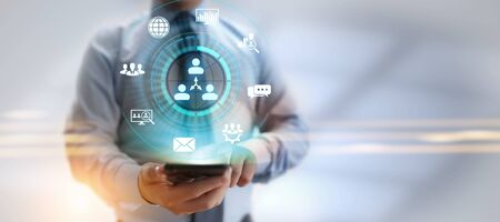 CRM - Customer Relationship Management. Enterprise Communication and planning software concept. Imagens