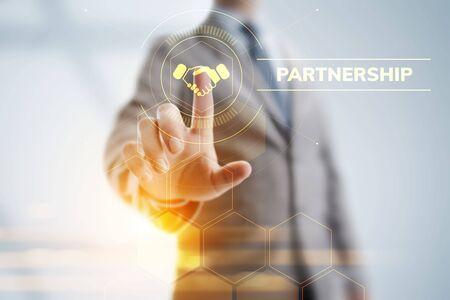 Partnership Business Finance concept on screen. Businessman pressing button. Zdjęcie Seryjne