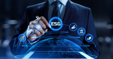 ESG environmental social governance business strategy investing concept. Businessman pressing button on screen. Stock Photo
