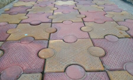 closeup image of 80 mm thick interlocking tile flooring laid outside of an residential building