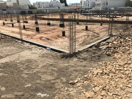 Foundation construction works includes sand filling pedestal concrete beam reinforcement and consolidation works for an house construction in an urban area as developer