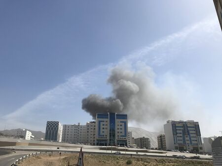 i have noticed heavy smoke coming out of an residential building due to fire from the kitchen or electric trip and needed a call for an emergency fire fighters Фото со стока