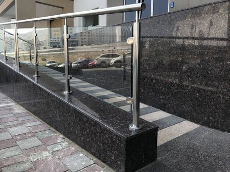 stainless steel chrome plated finished hand rails with glass panels for an ramp or staircase steps for an building interiors for better protection to avoid people falling
