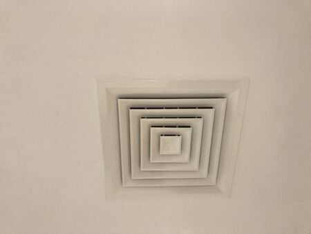 White color painted Suspended Gypsum false ceiling fixed with Supply diffuser 45 centimeters for Air conditioning system for an office building